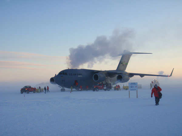 Airplane and Crew in Icy Cold Conditions